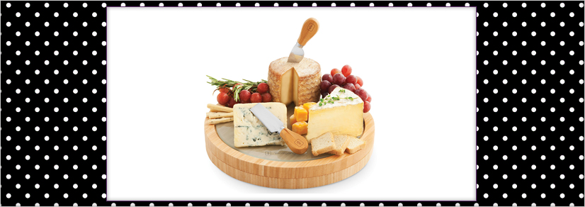 A large wooden centerpiece with assorted cheese and cheese knives