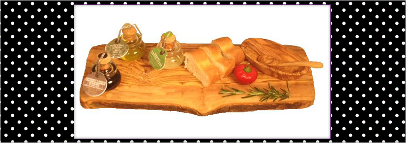 Large cheese board with cut bread and three jars